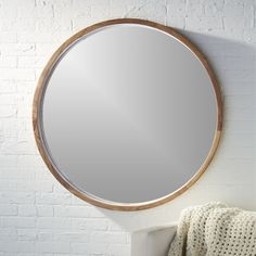 Solid sustainable acacia wood comes full circle to showcase a sweeping grain and warm hi/lo tones. Spanning over three feet in diameter, handcrafted wooden frame rings the inset mirror with depth. Round Wood Mirror, Round Mirrors, Large Circle Mirror, Cheap Mirrors, Mirror With Shelf, Mirror Set, Home Decor Mirrors, Wall Mirrors, Bathroom Mirrors