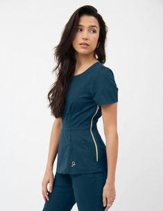 The Peplum Top in Caribbean Blue is a contemporary addition to women's medical scrub outfits. Shop Jaanuu for scrubs, lab coats and other medical apparel. Scrubs Outfit, Scrubs Uniform, Medical Uniforms, Medical Scrubs, Dental Scrubs, Nursing Clothes, Work Attire, Alter, Peplum