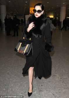 cecb72eb1c Is Dita Von Teese moving to London for good  Burlesque dancer touches down  at Heathrow with a ton of luggage