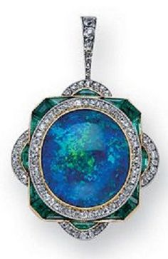 A Belle poque Jewelled Pendant circa 1895. Centring an oval black opal within a conforming diamond surround to a canted rectangular frame of calibr-cut emeralds the cardinal points further embellished by diamond crescents from a diamond-set bail in 18k gold and platinum. #opalsaustralia