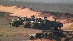 Syria war: US-led coalition 'strikes pro-Assad convoy' - BBC News
