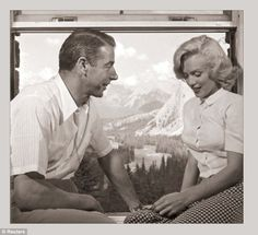 Marilyn Monroe is clearly smitten with baseball legend Joe DiMaggio while in Alberta, Canada, in the summer of 1953