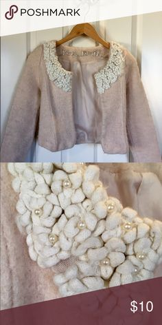 Pale Pink Cardigan Pale pink, wool cardigan with floral detail. Slight pilling. Sweaters Cardigans