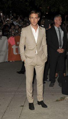 Ryan Gosling in bespoke cream suit and  white custom dress shirts.