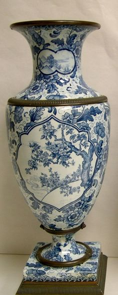"Royal Bonn, Porcelain Vases. Blue and white decoration in the ""Tokio"" pattern of scenic reserves, prunus and peonies."