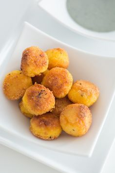 Polenta Balls with Gorgonzola Dipping Sauce (1 cup uncooked polenta (medium grain, quick cooking), 1/2 C grated parmesan or pecorino cheese, 1 T chopped mixed herbs (i.e. thyme, rosemary & sage), vegetable oil for frying, .25 oz. of gorgonzola cheese or any good melting cheese, and 3 T cream)