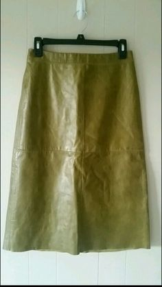 Size 2 Gap 100% leather skirt. In overall great condition.  Had a little mark that is pictured. Slip inside. Very well mad...