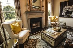 Stunning Study featuring a Wall of Large Windows for Natural Lighting & Detailed Fireplace  - Dogwood Model, Manor North – via Edward Andrews Homes