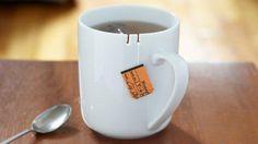 Tie Tea Mug, white mug with two slits to hold the string of the tea bag