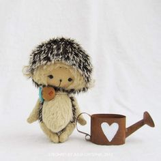 Hedgehog and watering can with heart