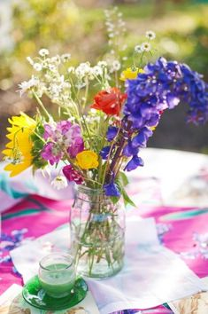 Reception idea, simple, eclectic vase with wildflowers centerpieces: Rustic-Barn-Wildflower-Centerpiece