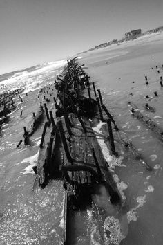 Ship wreck in Hatteras village.....we have sat right next to this  relaxing on the beach....sometimes it is exposed other times not at all