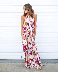We couldn't be more in love with our Adele Maxi Dress! A floor length maxi dress with a beautiful base and colorful flowers covering the dress. An adjustable halter neckline so you can create the perf