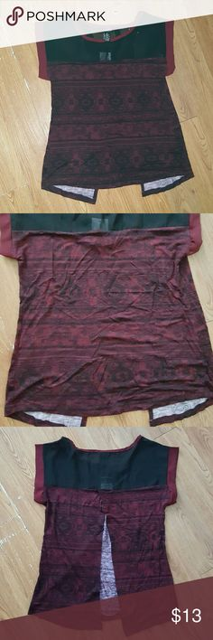 Wine and Black Blouse Split Back This is a cute blouse with an ethnic pattern all around the bottom part in black and red wine colors. The back of the blouse is split in the bottom part also. Short sleeves. Rue 21 Tops Blouses