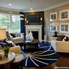 Corner fireplace round rug and furniture arrangement