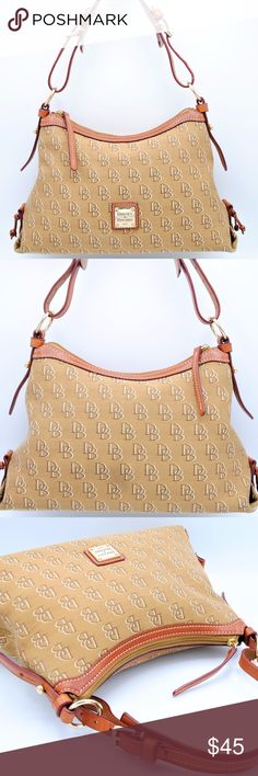 DOONEY & BOURKE Signature Brown Monogram Satchel Dooney and Bourke gold patch on the front, gold hardware.  Inside has a small slip pocket, key fob.  Very clean and good condition. Scuff mark on bottom right edge is only flaw.  Measurements: Height: 7.5'' Length: 13.5'' Depth: 5.5'' Drop: 9'' Dooney & Bourke Bags Shoulder Bags