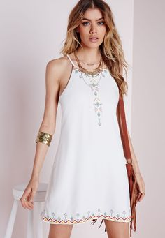 Look totally dreamy this summer in this chic white cami dress. With fanciful multi coloured embroidered detailing to the top and hem this dress with strappy feature to reverse will ensure you look effortlessly styled. Team with gladiator sa...