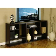 @Overstock.com - Multi-Purpose 3-in-1 Display Cabinet/ TV Stand/ Bookcase - this could go in living room or be the storage solution in the dining space. It measures 71' x 31' x 11'. http://www.overstock.com/Home-Garden/Multi-Purpose-3-in-1-Display-Cabinet-TV-Stand-Bookcase/6237505/product.html?CID=214117 $194.99