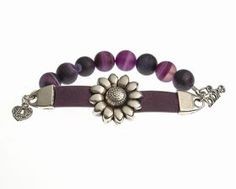 Show your beauty, strength, resilience and POWER with this exclusive Flower POWER bracelet designed and created by Rachel's Cure by Design. 25% of all sales go to support women reclaiming their lives from addiction. Available in purple or black.