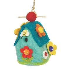 Felt Birdhouse Flower House Handmade and Fair Trade. This hand felted wool birdhouse is made of sustainably harvested, naturally water repellent wool. Surface moisture from dew, rain or snow quickly dries in the open air. Wool is also naturally dirt and mold resistant. The 1.25 inch hole can be enlarged to 1.5 inches to appeal to larger birds. Measures 9 inches tall by 5 inches wide.