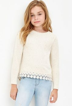 White knit sweater with light wash jeans. Cute school outfit for kids. Cute winter outfit for school or for any occasion