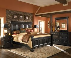 This is very similar to how our bedroom will look in the master....rock wall, paint color and bed...love it!