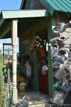 Galvanized watering cans hung a chain by Potting Shed | homeiswheretheboatis.net