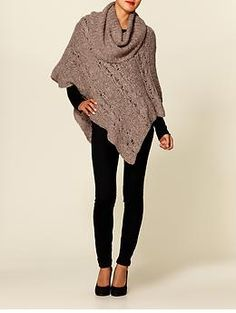 Cute poncho. Although I will get tired standing like this to get the angles right.