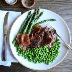 Spring on a plate. Slow Cooker Pot Roast with Onions Braised in Red Wine makes any house smell so good. Brightest green peas and asparagus are here purely to  shamelessly beg Spring to arrive and stay put. #thejudylab