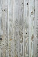 Whitewashing emphasizes the unsophisticated allure of knotty pine......one day,,,,,,,