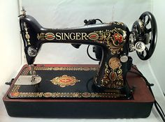 Antique 1914 Singer Red Eye Model 66 Sewing Machine Electric w/Case & Manual. I'm in love!