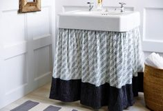 An Easy Way to Dress Up Your Sink Need more storage or just want to give your pedestal sink a new look? Skirt it! Special projects editor Megan Pflug shows how. Skirted Sink How-To  One Kings Lane