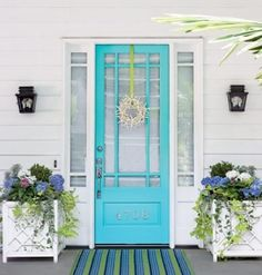 Grey house with teal blue door -