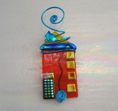 Home for the Holidays Ornament, Fused Glass in Bright Orange, Yellow and Dichro. $24.95, via Etsy.