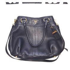 Prada Sacca 2 Manici In good condition!  Color- Black.  Has 2 handles as well as a shoulder/cross body detachable strap.  See photos for detail. Dust bag and authenticity certificate cards included! Prada Bags