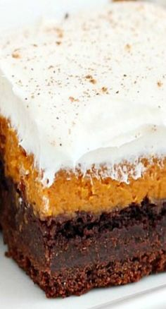 Chocolate Pumpkin Bars ~ layers or rich chocolate cake, silky pumpkin pie and light frosting and finished with a dust of cinnamon.