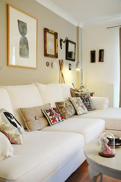 White sofa, neutral beige walls. Would make the space airy and open feeling, then could add as many pops of color with pillows, lamps, and pictures as you want