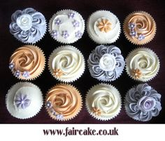 Vanilla buttercream cupcakes with fondant flowers by Fair Cake, via Flickr  Love he blue ones!