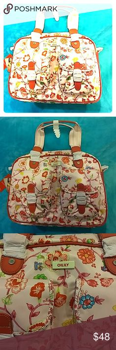 OILILY TRAVEL OR DIAPER BAG NEW WITH TAGS BEAUTIFUL Floral pattern with pink background and red trim. This bag is well made and sturdy. It also includes a shoulder strap and side rings for cross body wear. Equipt with a laptop pouch, this bag makes a great carryall, overnighter, travel bag, diaper bag, any combo of or all of the above as it is one of the companies most popular bags reported for it's versatility. Oilily Bags