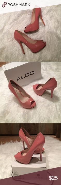 "Pink Aldo Peep-toe platform heels, 7 Gorgeous pink heels from Aldo, new in box, never worn. I bought two sizes to wear to my wedding, wore the other pair then lost the receipt. They are beautiful in person and comfortable too. The heel is 5:25."" There is a small flaw on the right side of the left heel so I lowered the price:) (see photo). Aldo Shoes Heels"