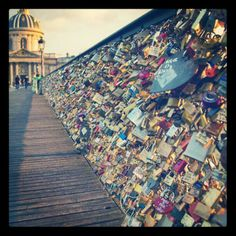 This is now on my bucket list for me & David. The Pont des Arts pedestrianbridgeinParis which crosses theSeineRiver.In recent years, many tourist couples have taken to attaching padlocks with their first names written or engraved on it to the railing or the grate on the side of the bridge, then throwing the key into the Seine river below, as a romantic gesture.This gesture is said to represent a couple's committed love.