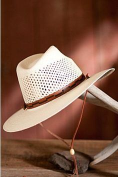 b892ded1297 Stetson s handsome genuine Panama straw hat has a fully vented pinch-front  crown that keeps