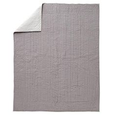 Shop Stitched Grey Blanket.  This reversible stitched grey blanket is like two blankets in one.  The front features a grey background with light grey kantha stitching and light grey trim, while the reverse side is solid light grey.