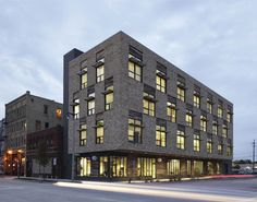 This project cleans up a brown-field site that was difficult to develop.  Dig the retail concourse.  Clock Shadow Building, Milwaukee by Continuum Architects + Planners