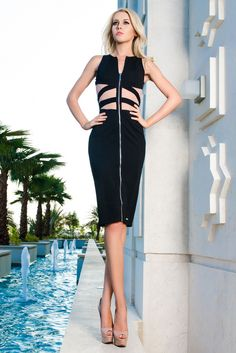 This black cocktail dress has a long provocative zip and revealing transparent mesh cut outs.