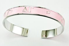 Beautifully crafted Delta Gamma jewelry pieces by The Collegiate Standard - bracelet available in pink and blue