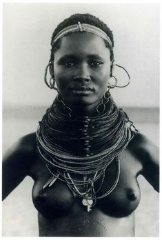 Africa |  Although no details are provided, I would say that this is a Rendille woman based on the necklace she is wearing.