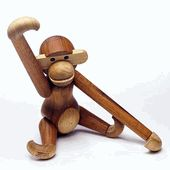 This classic example of Danish modern design was created in 1951.Kay Bojesen: Wooden Monkey with moveable head and limbs Rosendahl, Denmark monkey was designed in 1951. My sister Nancy had one when she was a kid and named it Bongo.