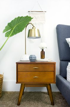 A round up of affordable mid century modern nightstands all under $200, the perfect addition to any modern master bedroom design!