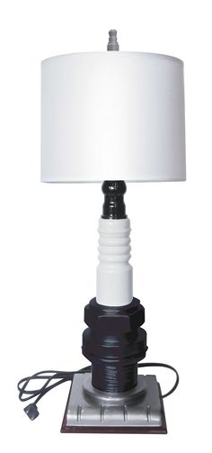 Toss out that old frilly lamp and light up the man cave with a little more spark! This highly detailed, cast resin spark plug lamp is hand painted to look like the real deal. Some greasy fingerprints are all it needs! $49.95